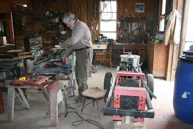 Ken in the Workshop Retrofitting Transplanter to be Pulled by Horses