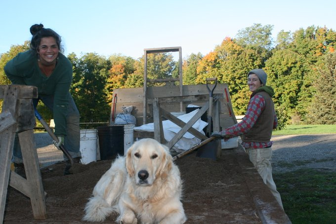 Jayme and Caitlin Making Potting Soil with Caesar Supervising