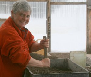 Mixing up Potting Soil in Greenhouse