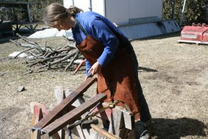 Naomi, using Cutting Torch to Cut Steel for No-till Drill