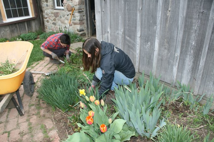 Jeanne and Alina Weeding Flower Gardens
