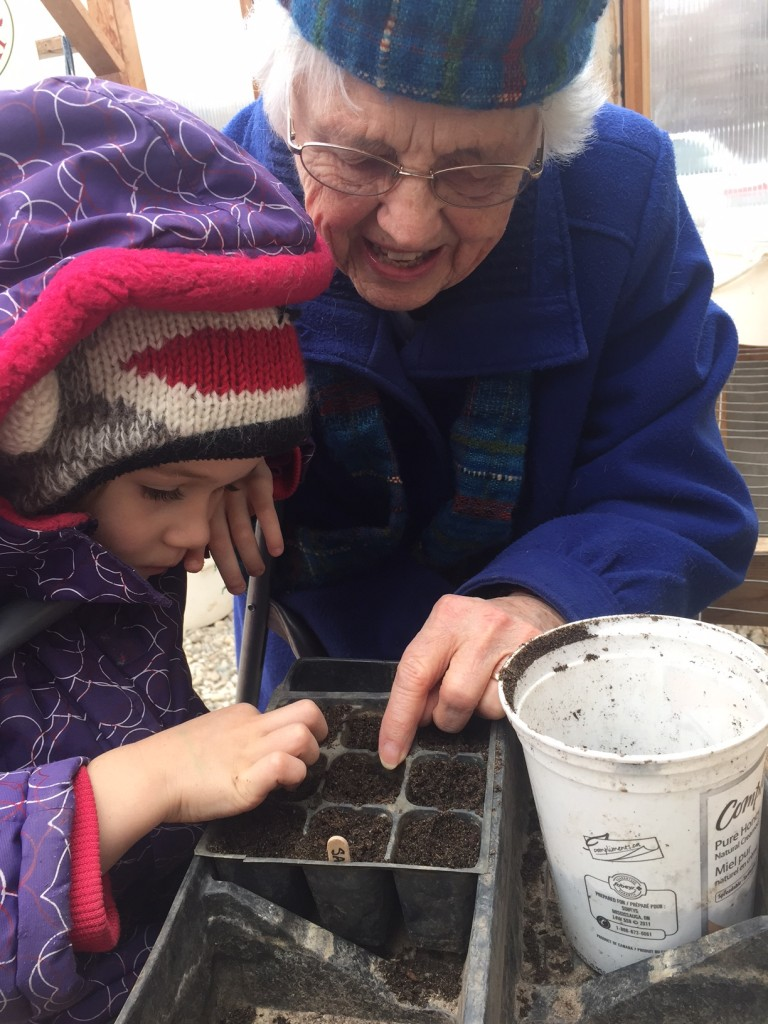 Della Jane and Great-grandmother Jane Planting Sage